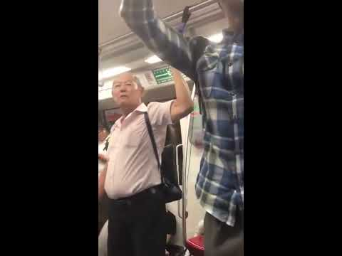 Singaporean 'gay' elderly slaps American tourist in the train!