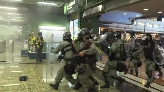video: Hong Kong flights cancelled as thousands protest at airport after night of violence