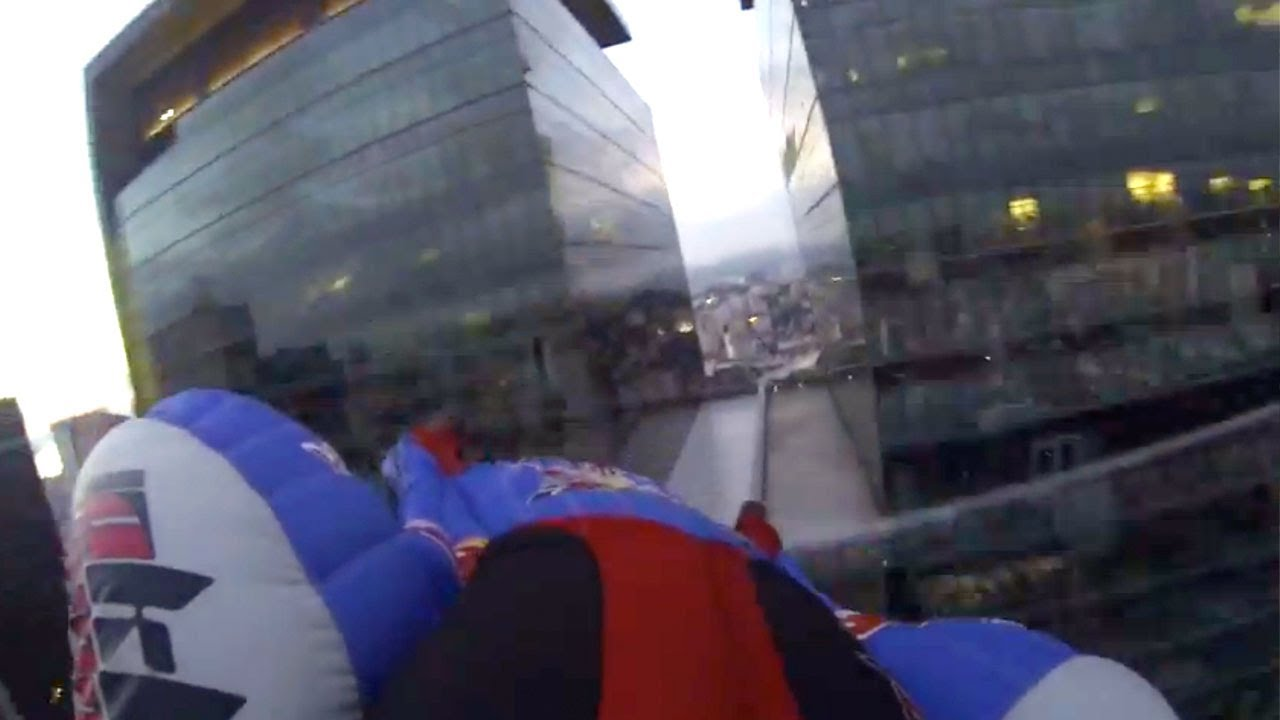 Watch These Real-Life Supermen Wingsuit Dive Into Their Metropolis