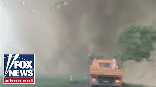 Raw video: Tornado rages past motorists in Germany - Video Youtube