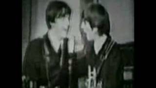 Paul McCarteny and George Harrison. (In Spite of All the Danger)