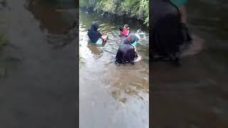 Cambodian Muslim taking a bath in stream