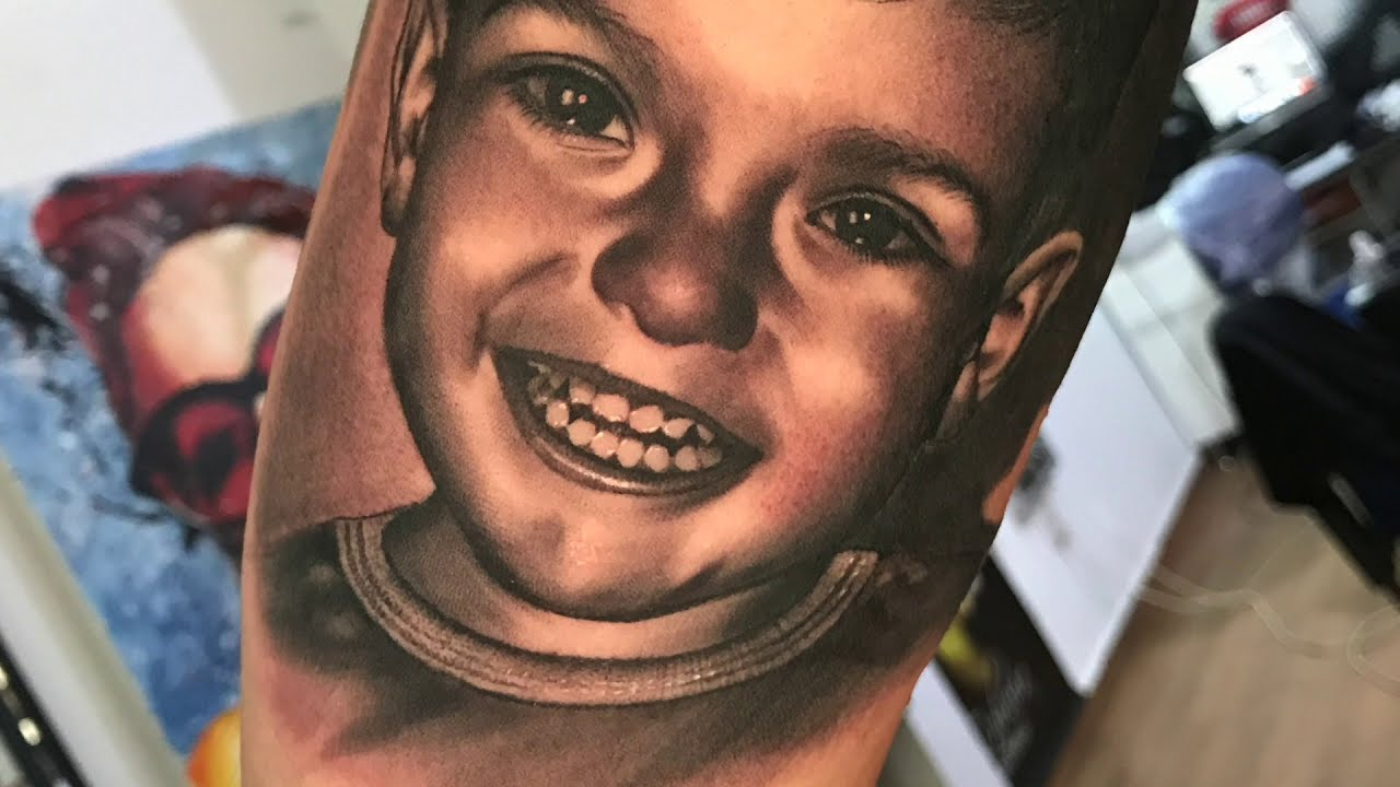 tattoo of a realistic child face by florin zaharia