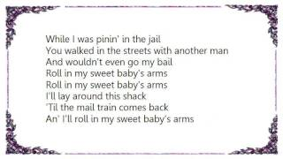 Boxcar Willie - Rollin' in My Sweet Baby's Arms Lyrics