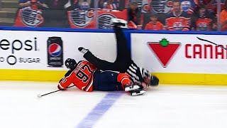 Linesman stretchered off after collision with McDavid