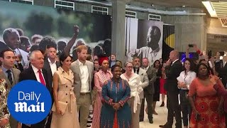 Beaming Prince Harry and Meghan open Nelson Mandela exhibition - Daily Mail