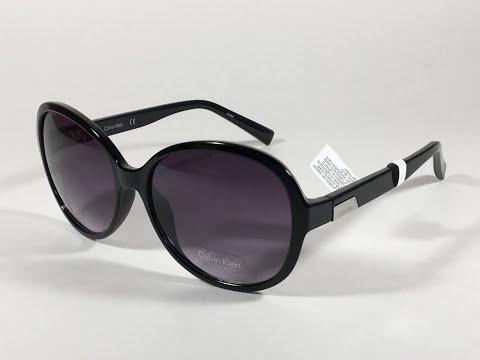5daa9930345 Authentic Calvin Klein R701S 001 Oval Sunglasses Black Gloss Frame Gray  Gradient Lens