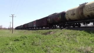 2ТЭ116 -1460 с грузовым поездом торможение, и отправление.