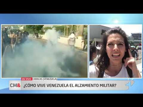 Centenares de venezolanos salen a las calles de Caracas en apoyo a Guaido