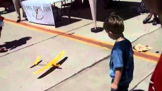 Alex being chased around by a model plane - Wings over Camarillo