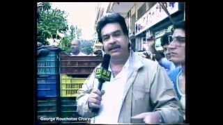 """Aπόσπασμα απο την εκπομπή """"Κάμερα Αλήθεια"""" με τον Βασίλη Μπουγιουκλάκη σε ζωντανό ρεπορτάζ σε λαϊκή αγορά όπου έμεινε στην ιστορία.. (από soulto, 25/03/15)"""