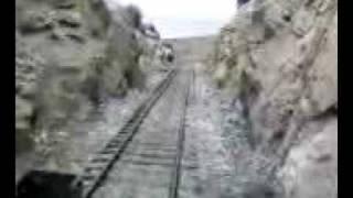 Train going backwards through cut
