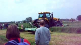 JCB 8250 Mowing With Krone Triples