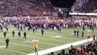 Utah vs USC - Fans rush field after victory.