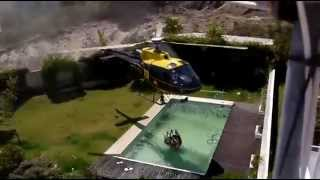 Helicopter Refills Its Water Bucket From Swimming Pool