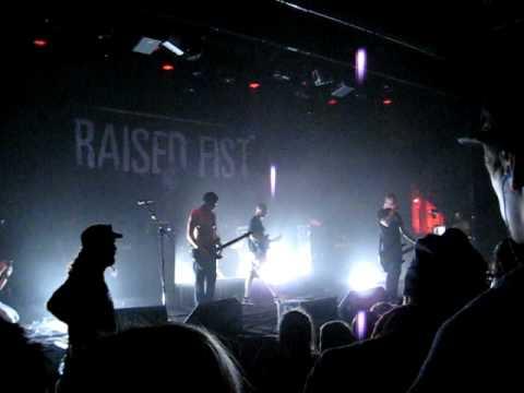 Raised fist breaking me up