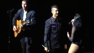 Joe Jonas and Demi Lovato singing 'This is Me' with Nick on guitar