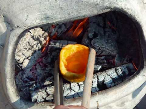 Use An Orange Peel To Cook An Egg Over A Campfire