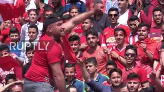 Syria: Wild football fans fill Aleppo stadium seats in free-for-all match