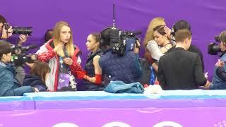 2018-02-23 Zagitova & Medvedeva hug their coaches