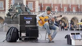 The Busking Guy Performs Guitar On The Street, It
