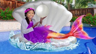 Wendy pretend play as Princess mermaid Ariel and has a birthday pool party! Auntie told Wendy to finish her homework and then she can play. Auntie makes Wendy a surprise birthday pool party by buying a bunch of Ariel stuff. Uncle K arrives with a mermaid tail, Ariel kitchen, and giant shell inflatable float toy. They surprise her and play in the swimming pool together!