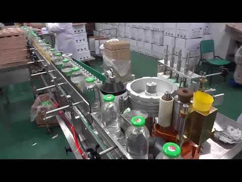 Máy dán nhãn keo hồ cho chai tròn