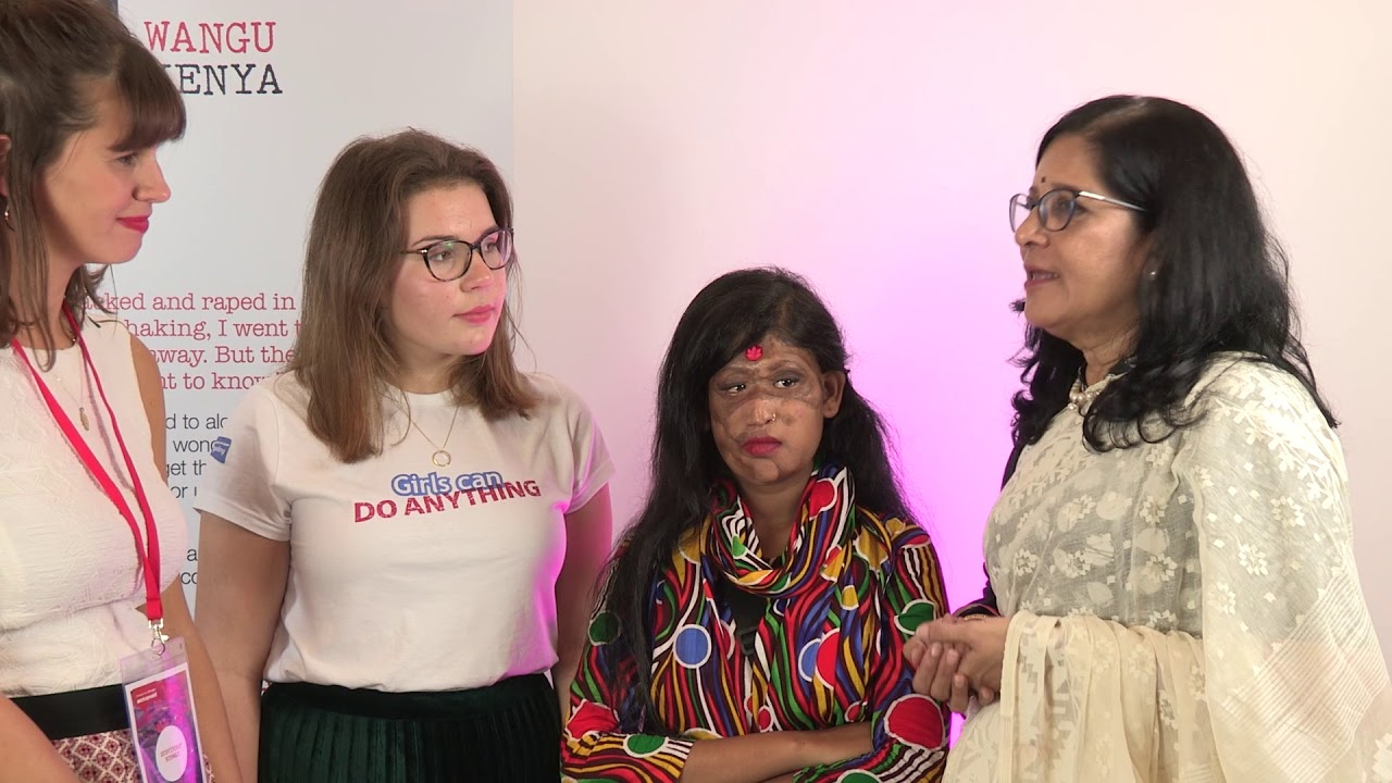 16-year-old UK Girlguide, Caitlin, meets 14-year-old acid attack survivor Sonali, from Bangladesh, after ActionAid's Survivors' Runway fashion show