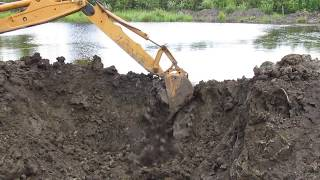 CASE 580 Super L Extendahoe breaches the dam and here comes the flood!