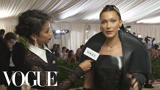 Bella Hadid on Her 10-Pound Sewn-In Veil | Met Gala 2018 With Liza Koshy | Vogue - Video Youtube