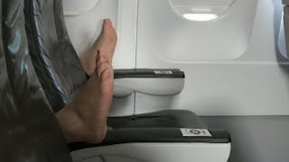 Woman on Airplane Says She Watched Passenger Open Window With Bare Feet