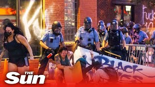 George Floyd protest – Looters shot, cop cars smashed and fires rage as riots engulf Minneapolis
