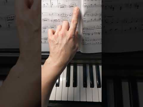 Demonstrating a practice strategy I teach to my piano students to help them play fast notes evenly.