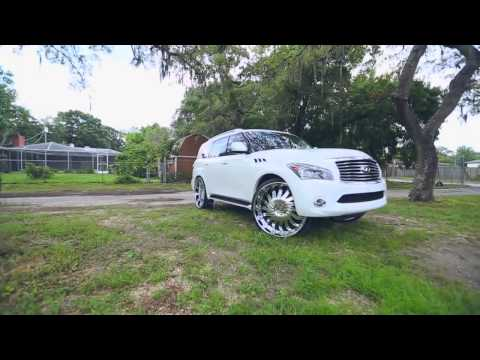 "White Infiniti QX56 on 30"" AMANI FORGED RIMS"