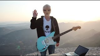 An alien playing guitar (GRAViiTY - Rising Sun)