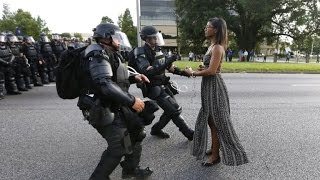 See Powerful Image of Woman Wearing Dress While Facing Police During Protest