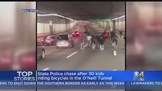 30 Kids On Bicycles Ride Through O'Neill Tunnel Traffic