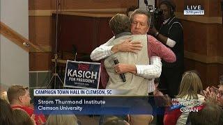 John Kasich hugs supporter (C-SPAN)