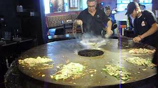 Cooking on that big round thing at the HuHot Mongolian Grill - Colorado