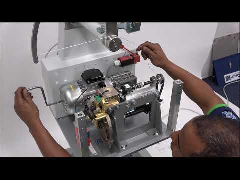 AXRO FQC2: L'élastique ne s'insère pas correctement dans la machine
