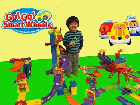 Kid playing with toys Vtech Go Go smart wheels review amazement park train station