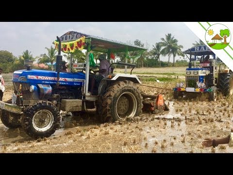 Testing new powertrac tractor pulling Swaraj 744 FE tractor stuck in mud - Come To Village