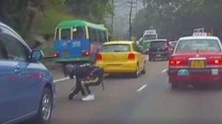 Hong Kong biker risks his life to save kitten stuck on busy road