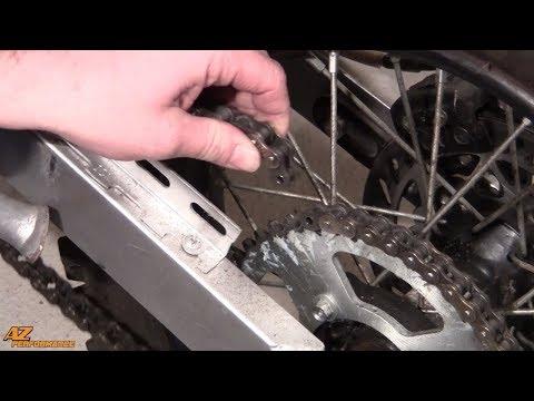 Tuto de remplacement du pignon de sortie de boite de vitesse et réglage de chaine sur moto 50cc