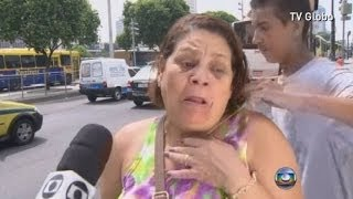 Man Tries To Snatch Womans Necklace As Shes Interviewed On TV