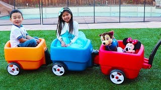 Emma and Lyndon are Having Fun with Step 2 Wagon Toy