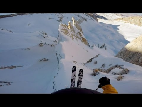 Daredevil Skis Through An Impossibly Narrow Gap In The Mountains