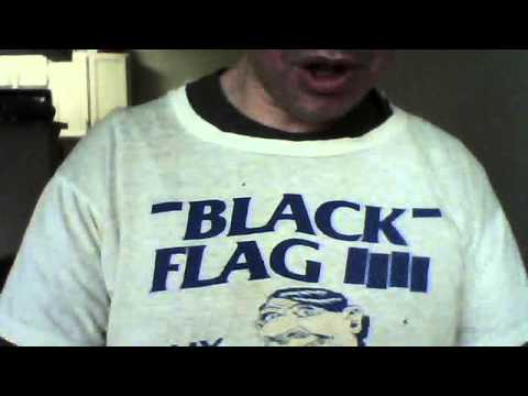 jerk in a vintage black flag t-shirt softly croons a ballad for world peace
