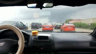 preview picture of video 'Abidjan : De l'arrière de mon taxi le mardi 29 juillet entre l'échangeur et l'école de Police'