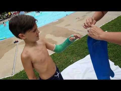 Alec swimming with waterproof cast cover